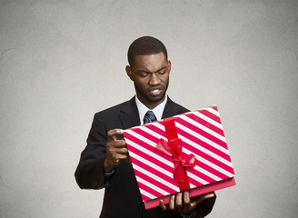 Unhappy man, displeased with new gift he received