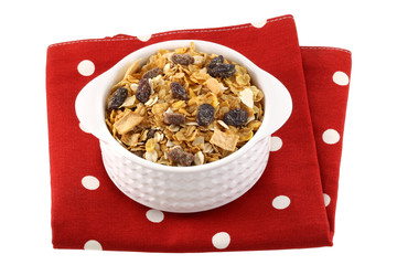A bowl of breakfast cereals with dried fruit