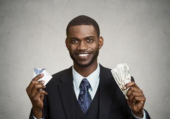 Happy businessman holding dollar, euro bills