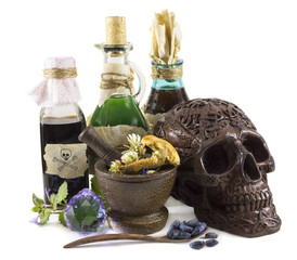Magic still life with skull and bottles