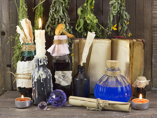 Homeopathic still life with candle and bottles