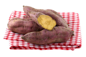 Raw Sweet Potato with dirt on skin, isolated on white
