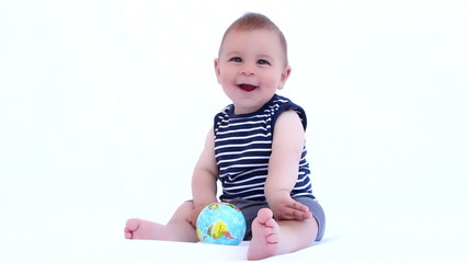 Baby boy playing with globe ball on a white background