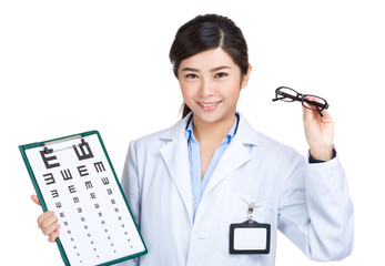 Female doctor hold eyeglasses with eye chart