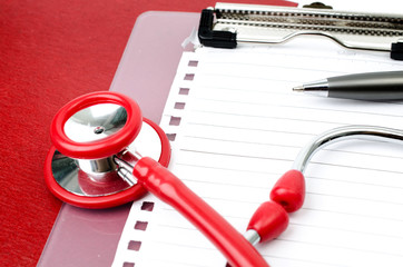 Stethoscope with plastic clipboard , blank paper and pen