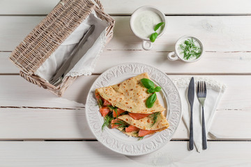 Pancake with salmon, dill and cream