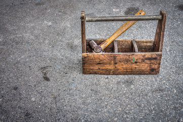 Vintage wooden toolbox and hammer for construction work
