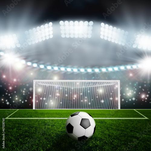 Fotobehang Stadion Soccer ball on green stadium arena