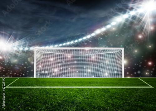 Soccer ball on green stadium arena - 67029190