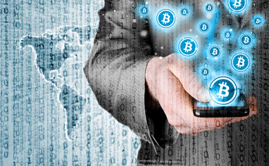 Hand with mobile smart phone and bitcoin symbol