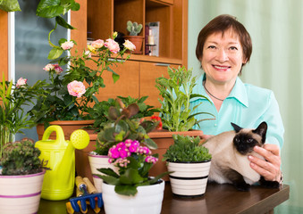 Portrait of female pensioner with decorative plants