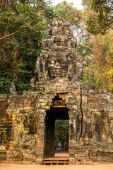 Ancient gates of Angkor Thom in Angkor Wat complex, Siem Reap, C