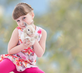 girl kissing a rabbit