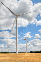 wind turbine blades on blue cloudy sky background