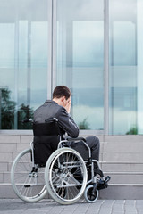 Stressful man on wheelchair before work