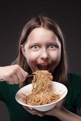 Teen girl greedily eating