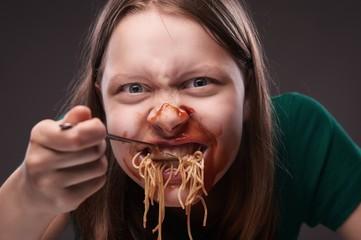 Teen girl furiously eating