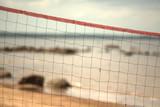 Fototapeta volleyball net on the beach close-up.