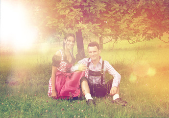 Couple in Bavarian clothes posing together outside