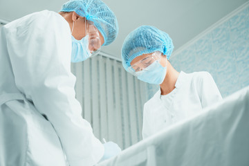 Two surgeons in operating room
