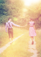 Couple in Bavarian clothes walk together outdoors