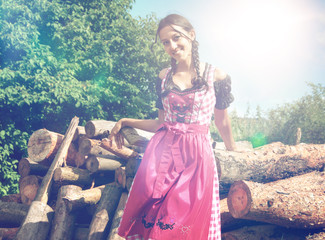 Bavarian girl in dirndl posing outside in nature