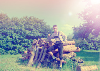 Handsome guy in Lederhosen posing outside