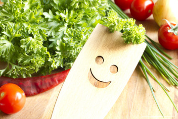 Wooden kitchenware on cutting board with vegetables