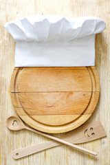 Chef hat on cutting board abstract food concept