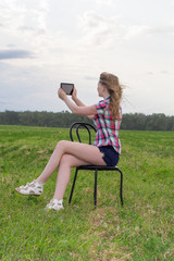 girl on a chair in a field