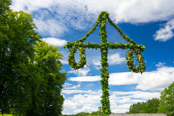 Swedish midsummer pole at blue sky