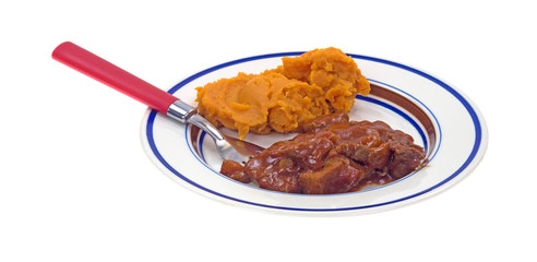 Beef and sweet potato TV dinner on plate