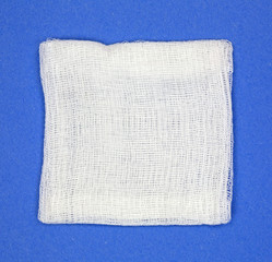 Gauze pad on blue background