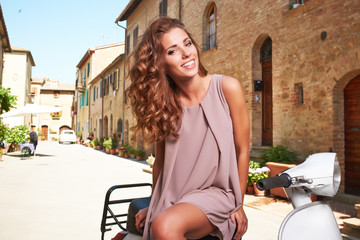 beautiful woman in summer dress  in Tuscany, Italy.
