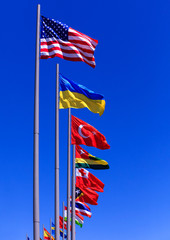 Flags against blue sky