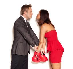 Boyfriend restraining girlfriend from fighting