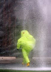 spray of water toward the person with the suit during an evacuat