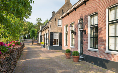 Herengracht  street with historic houses in the Dutch village of