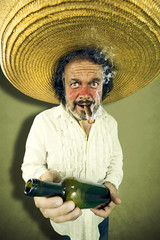 Crazy mexican man offering rum while smoking