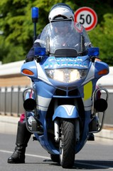 Police motorcycle COP while patrolling the road and check motori