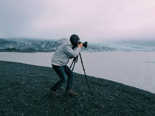 Photographer with a tripod in Skaftafell glacier, Iceland