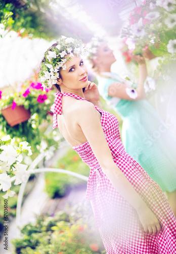 Two beautiful women in the huge garden