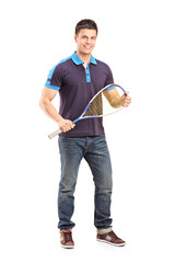 Full length portrait of a young male racquetball player