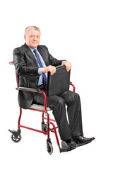 Elegant mature businessman sitting in wheelchair