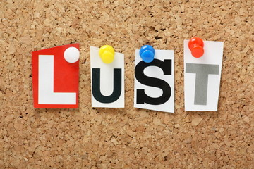 The word Lust on a cork notice board