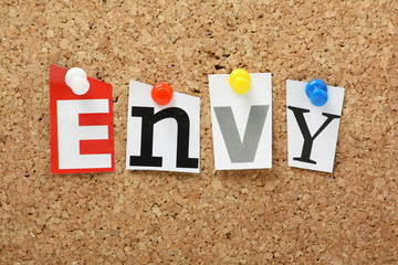 The word Envy on a cork notice board