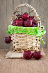 Cherries on wooden table and cherry juice