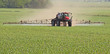 Leinwanddruck Bild - Spraying a Corn Field