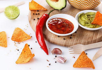 Mexican food concept – Doritos, guacamole and salsa