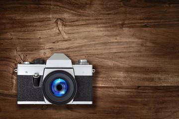 slr camera on wood